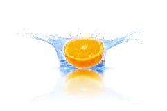 Orange falls into the water Royalty Free Stock Photos