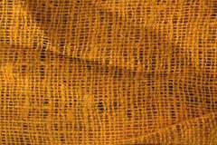 Orange Farbe zerknitterte Textiloberfläche stockbilder