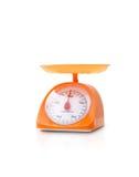 Orange Farbküchenskala Stockfotos
