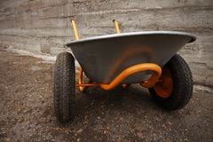 Orange farmer's two wheelbarrow Royalty Free Stock Photos