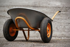 Orange farmer's two wheelbarrow Stock Images