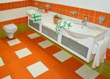 Orange faucets Stock Photo