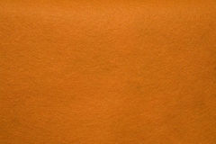 Orange felt. Texture. Useful as a background or texture effect stock images