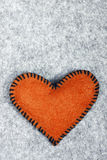 Orange felt heart Stock Images