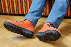 Orange felt shoes. Stock Images