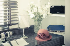 Orange female hat on dressing table Royalty Free Stock Photography