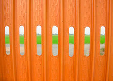 A Orange fence. And external environment Stock Photos