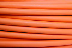 Orange fiber optic cable background Stock Photography