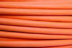 Orange fiber optic cable background Stock Photography