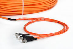 Orange fiber optic ST connector patchcord Stock Photo