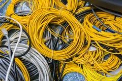 Orange fibre or fiber optic cables. Close up of orange fibre or fiber optic cables stock photography