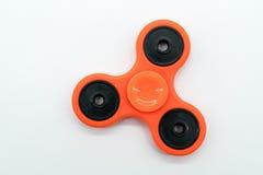 Orange fidget spinner Stock Photos