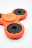 Orange fidget spinner Royalty Free Stock Photo