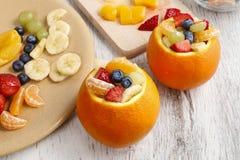 Orange filled with fruit salad Stock Photography