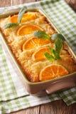 Orange filo pie portokalopita close-up in a baking dish. vertica Stock Image
