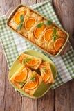 Orange filo pie portokalopita close-up in a baking dish. Vertica Stock Photo