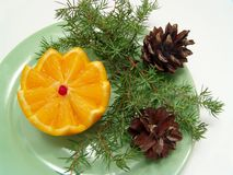Orange and fir cones Royalty Free Stock Image
