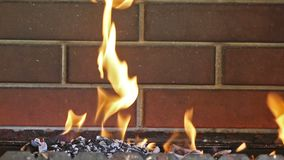 Orange fire on brick wall background stock video footage