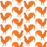 Orange fire decorative rooster on white background seamless pattern. Stock Photos
