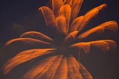 Orange Fire Flower in the Sky. Orange firework flower looking in the sky Royalty Free Stock Photo