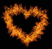 Orange fire heart on black. Orange heart shape flame isolated on black background Stock Images