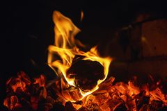 Orange fire. Fire in a hot oven. Burning firewood stock image