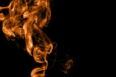 Orange fire smoke on black background Stock Images