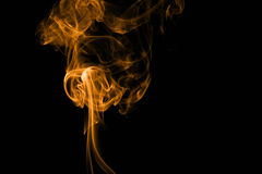 Orange fire smoke on black background Stock Photos