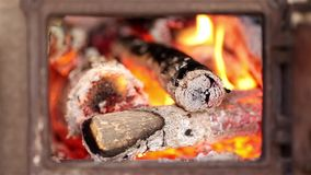 Orange fire with wood ashes Stock Photography