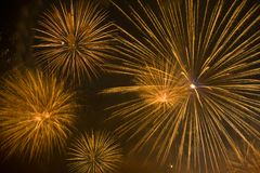 Orange fireworks in night sky Stock Images