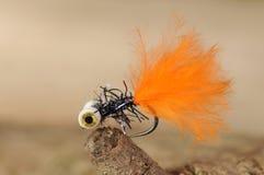 Orange Fischereiköder stockfotos