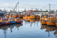 Orange fishing boats in Mar del Plata, Argentina. MAR DEL PLATA, ARGENTINA - APR 04: Typical orange fishing boats on the port of the coastal city on Apr 04, 2013 Royalty Free Stock Images
