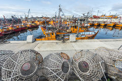 Orange fishing boats in Mar del Plata, Argentina. MAR DEL PLATA, ARGENTINA - APR 04: Typical orange fishing boats on the port of the coastal city on Apr 04, 2013 Royalty Free Stock Image