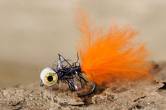Orange fishing fly Royalty Free Stock Image