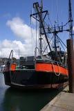 Orange fishing trawler. Tied up on a wharf in  Yaquina Bay, Newport,  Oregon Coast Royalty Free Stock Image