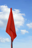 Orange flag on the blue sky. Royalty Free Stock Photography