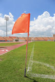 Orange flag at one corner of football or soccer stadium Stock Photos