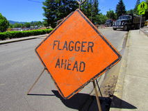 Flagger Ahead Sign stock images