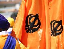 Flags with khanda symbol of sikhism. Orange flags with khanda symbol of sikhism Royalty Free Stock Images