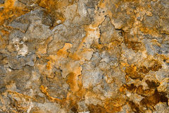 Orange flake Stone wall background texture Royalty Free Stock Image