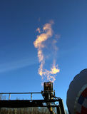 Orange flame bursts from the gas burners of the balloon Stock Images
