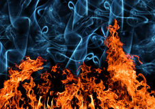 Orange flame with smoke on black Stock Photos