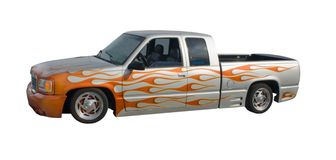 Orange flamed lowrider truck. Custom low-rider styled extended cab pickup truck Stock Photo