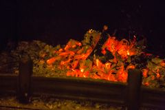 Orange flames in ash in fireplace Royalty Free Stock Photo