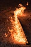 Orange Flames on black background Stock Image