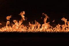 Orange Flames on black background Royalty Free Stock Photography