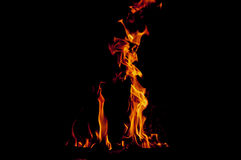 Orange flames. Flames in black background, fire place Stock Images