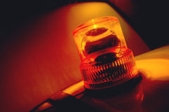 Orange flashing and rotating light Stock Image