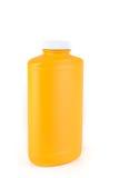 Orange flaska av fotpulver Royaltyfri Foto