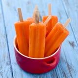 Orange flavored ice pops Stock Photo